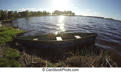 old wooden fishing boat on lake