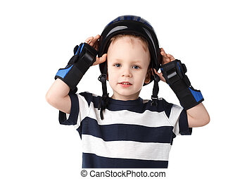 little boy in a protective wrist pads puts or removes the...