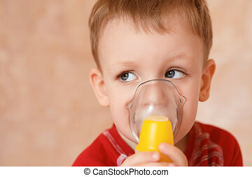 Sick little boy makes inhalation mask for breathing at home...