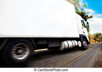 Truck and road - truck carrying merchandiseClose up image of...