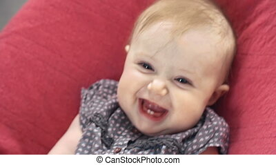 Baby Rocker - Extreme close up of sweet baby rocking in the...