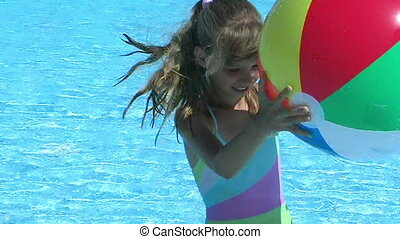 Child swimming in pool - Child swimming in pool and playing...