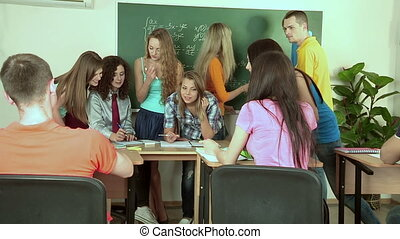 Students in discussing problem of class. - Students with an...