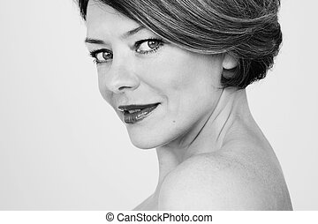 Middle age beauty - Black and white close up portrait of...