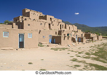 Adobe Houses in the Pueblo of Taos, New Mexico, USA. -...