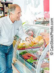 Man buying meat