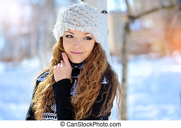 Woman hugging herself cold in winter time