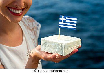 Traditional greek feta - Holding in hand traditional greek...