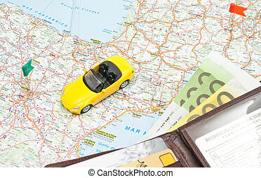wallet and sport car on map of Europe