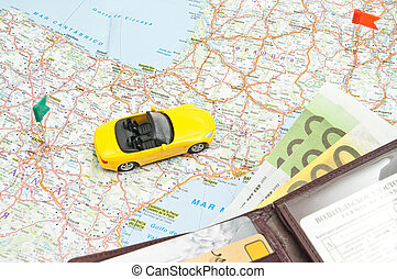 wallet and yellow car on map of Europe