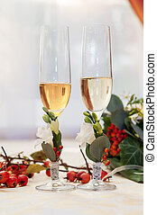 Two empty wedding champagne glasses on a table