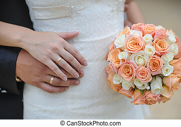 flowers wedding rings hands