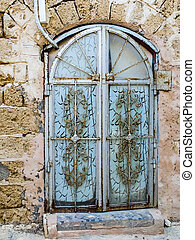 Ancient door with a decorative lattice in the city of Jaffa,...
