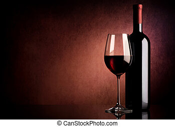 Wine on vinous background - Red wine in bottle and wineglass...