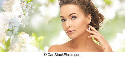 woman with diamond earrings - people, beauty, jewelry and...