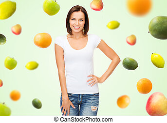 happy woman in blank white t-shirt over fruits - people,...