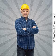 smiling male builder or manual worker in helmet - repair,...