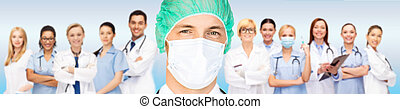 surgeon in medical cap and mask over team