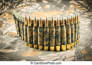 camouflage ammunition belt for rifle on camouflage...