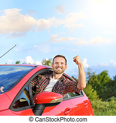 Man in car - Attractive man stuck his hand out of the window...