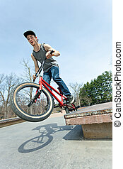BMX Rider Grinding - BMX rider athlete griding the rear pegs...