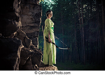 Elf woman with the magic bow on the forest background - Elf...