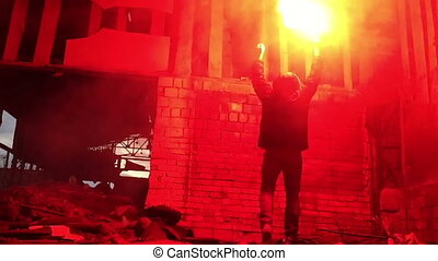 red hand flare. distress signal - Man hold red flare in...