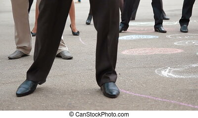 Guests Making Steps At Wedding Party - Waist down shot of...