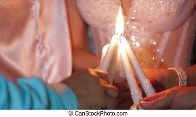 Beautiful Newlyweds Igniting Candles