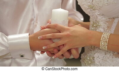 Married Couple Holding Unity Candle