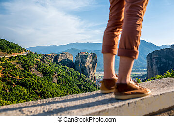 Man on the mountains - Man standing on the road on beautiful...