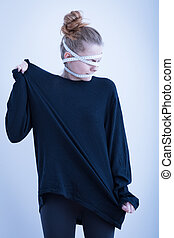 Girl wrapped in measuring tape - Despair anorexic girl...