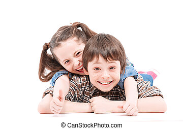 Brother and sister having fun on the floor