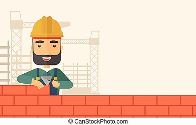Builder man is building a brick wall - A smiling builder...
