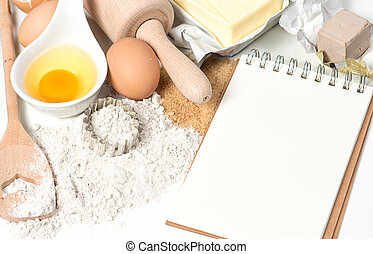 Recipe book and baking ingredients Food background - Recipe...
