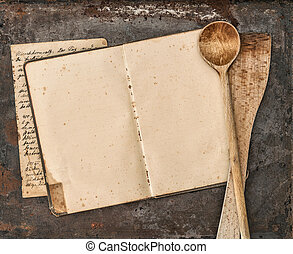 Vintage handwritten recipe book and old kitchen utensils
