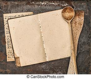 Vintage handwritten recipe book and old kitchen utensils
