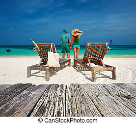 Couple in green relax on a beach at Maldives - Couple in...