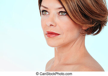 Woman looking aside - Close up portrait of beautiful middle...