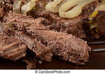Sliced pot roast - Close up of slice pot roast with onions
