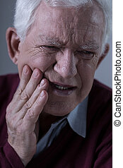 Horrible toothache - Old man with horrible toothache