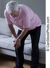 Man with pain - Elderly man with knee pain