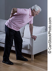 Man with sciatica - Retired man with sciatica spasm