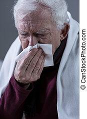 Cold elderly man