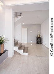 Hallway with stairs - White clean hallway with wooden stairs...