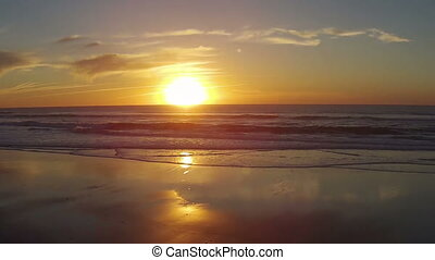 Aerial from sunset at the ocean - Aerial from the sunset at...
