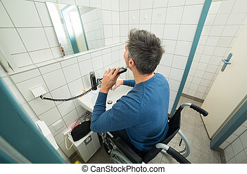 Disabled Man Trimming Beard - Disabled Man On Wheelchair...