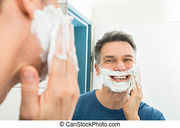 Happy Man Applying Shaving Cream