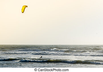 Kitesurfer on a beautiful background of spray during the...