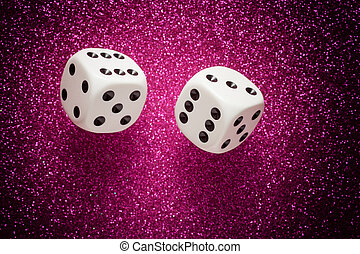 White dice - Rolling white dice over purple glittering...